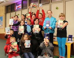 Local author, Becky Titelman, poses with happy audience after