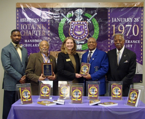 IOTA NU CHAPTER OF OMEGA PSI PHI FRATERNITY DONATES BOOKS TO LIBRARY