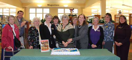 Photo caption: Customers and staff gathered January 5th to celebrate the Whiteford Library's 35 years of service to the community. From left to right, Friends member Margaret Harkins, Senior Administrator of Public Services Joe Thompson, staff member Ann Winkler, Whiteford Library Manager Linda Zuckerman, staff member Kristen DeLambo, North Harford Friends President Betsy Galbreath, former Whiteford Library Manager Heidi Richardson, Harford County Public Library CEO Mary Hastler, staff member Bernadette MicKey, staff member Charlotte McCall and Senior Administrator of Human Resources Terri Schell.