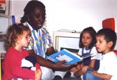 Volunteer reading at a day care